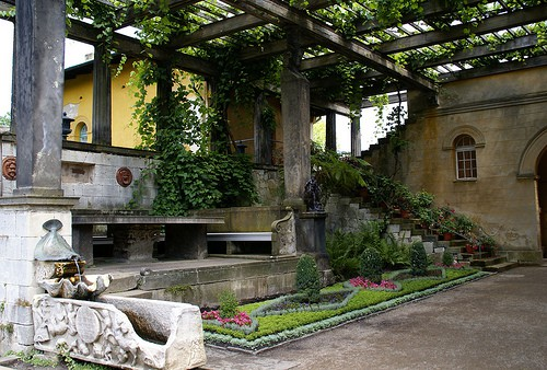 Vine covered loggia at roman bath