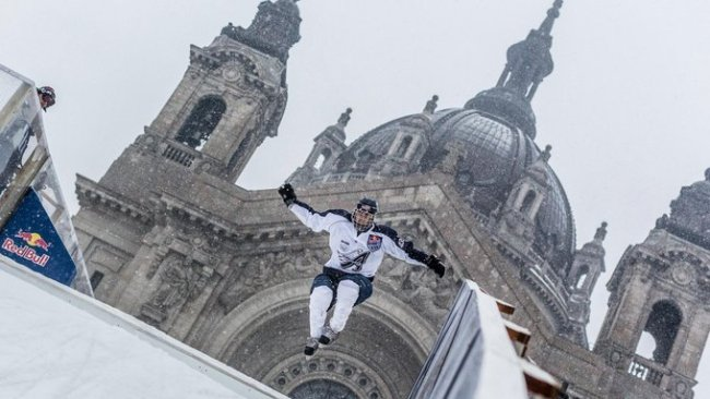 David Gross of the USA performs during the national shootout of the Red Bull Crashed Ice the second stop of the Ice Cross Downhill World Championship on February 21, 2014 in Saint Paul, MN, United States of America.