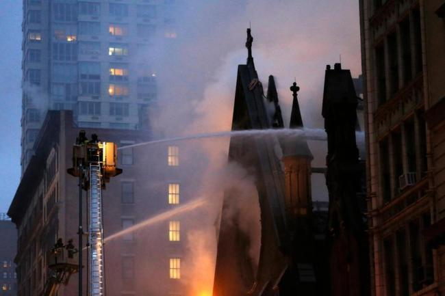 Image 13_Fire fighters attempting to douse the flames