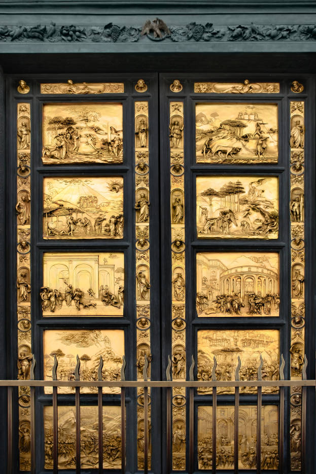 Gates of Paradise with Bible stories on door panels of Duomo Baptistry, Florence, Italy